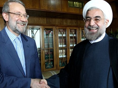 President-elect Hassan Rohani (R) shakes hands with Majlis Speaker Ali Larijani on June 16, 2013. (Photo: Press TV)